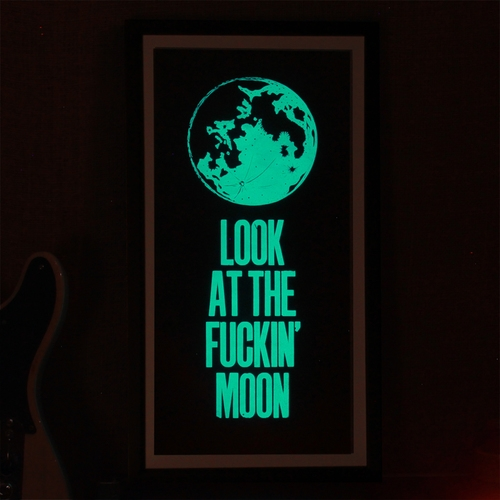 "15. ""LOOK AT THE FUCKIN' MOON"" ART PRINT €50.00 'Look At The Fuckin' Moon' is a limited edition print by letterpress artist Dave Darcy, inspired by lyrics from the Jape song 'Phil Lynott' - a glorious wee song celebrating Dublin musicians and lunar eclipses. Printed in two colours, plus an additional dusting of photo luminescent powder to add that full moon glow."