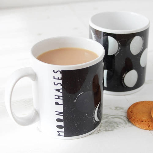 "2. ""REACH FOR THE MOON"" MUG €12.50 This gorgeous starry night mug shows the 8 moon phases with their correct names, along with a little description about what moon phases actually are."