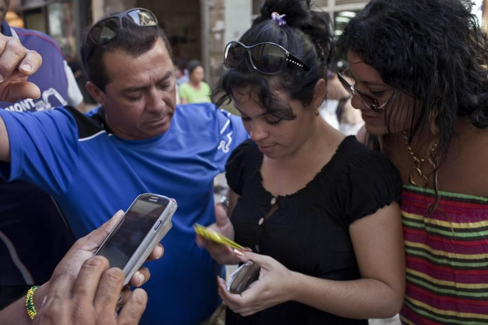 Cubans using cell phones, which their communist government allowed them to purchase for personal use in 2008.