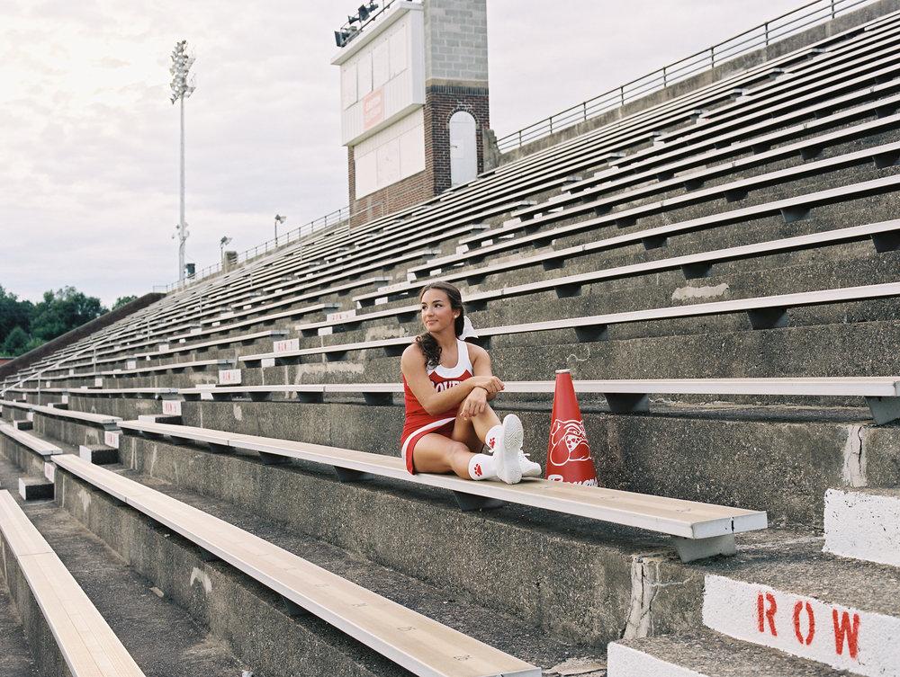 Cheerleader in bleachers