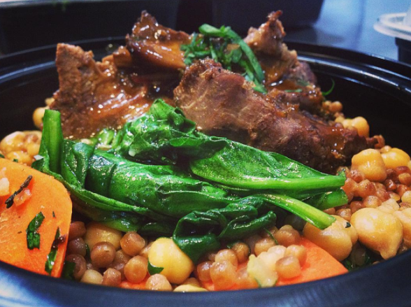 Braised Lamb with  chickpeas, glazed carrots, olives, couscous, and spinach
