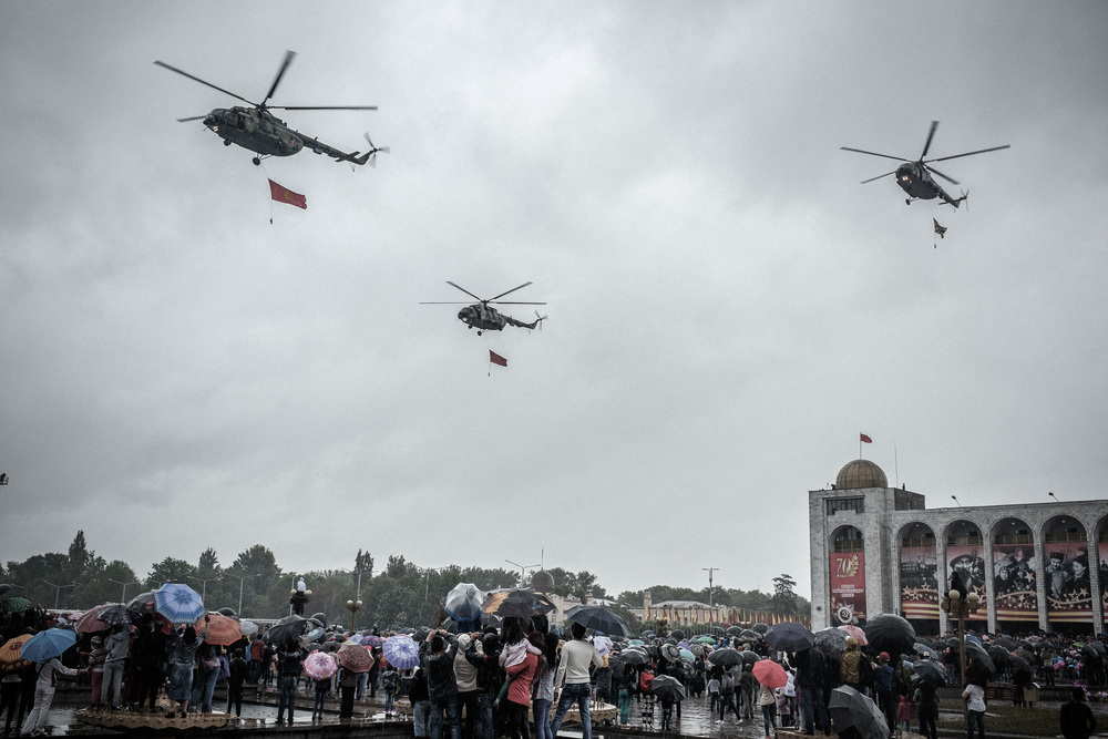 Mi-8 helicopters fly over Bishkek's Ala-too square during the 70th anniversary military parade of the Great Victory. The air force participated in the celebration for first time. Bishkek, may 9, 2015