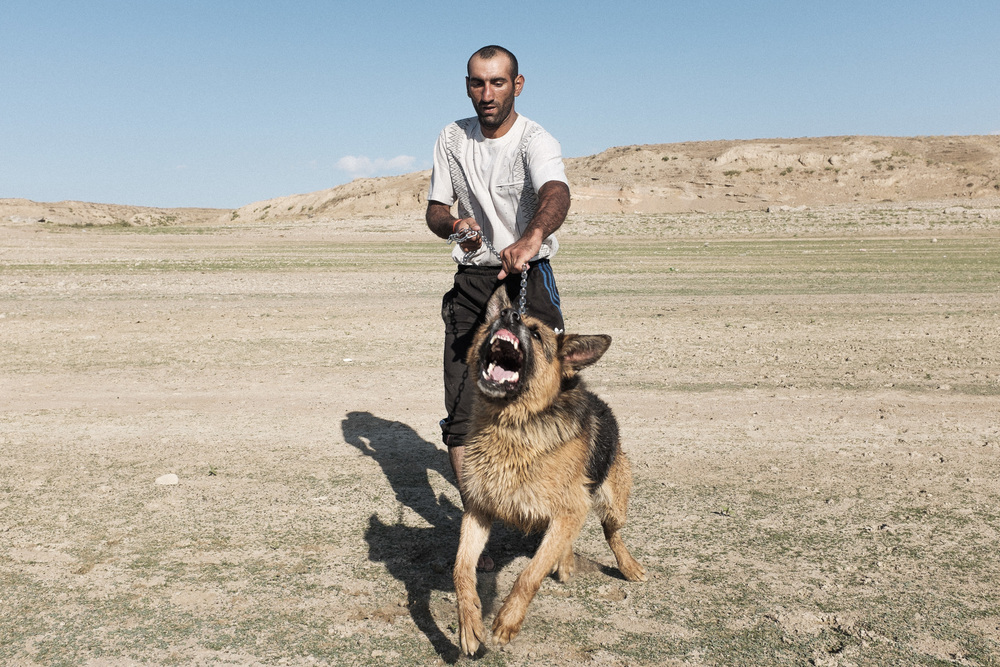 Afghan man with German Shepherd 2. Kirov Reservoir, Talas region