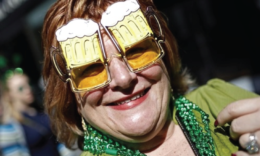 A woman wears beer mug glasses as she joins thousands celebrating along 5th Avenue in New York during the city's 250th annual St. Patrick's Day parade on March 17, 2011.   Mike Segar / Reuter