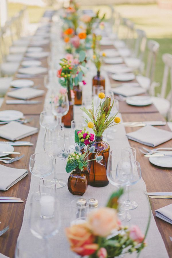Tip: For long banquet tables I love using long runners and playful, small vases // It's continually beautiful