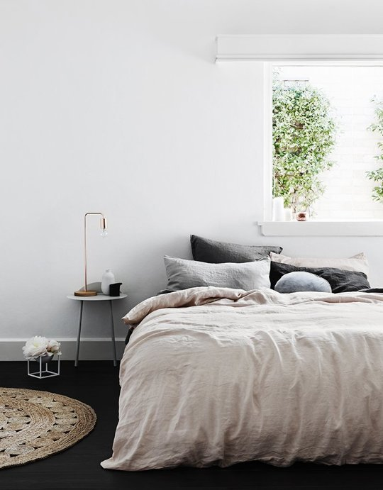 Look for bedding that is neutral or bright white, this allows your space to feel open + airy. Linen has become my new favorite obsession as  it doesn't take long to get that worn in look. Don't worry, you can add color later.