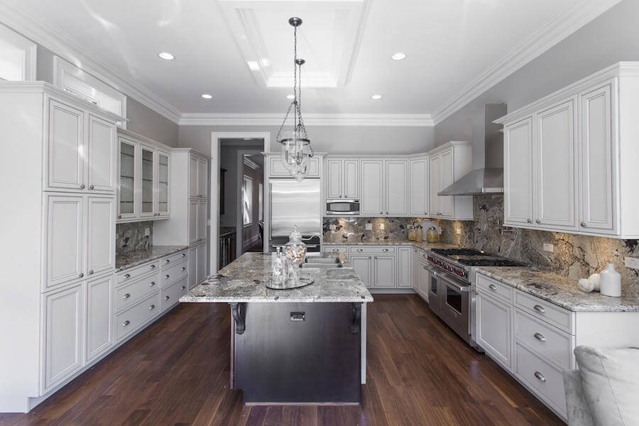 Mostly monochromatic kitchen with varying tones of white and gray