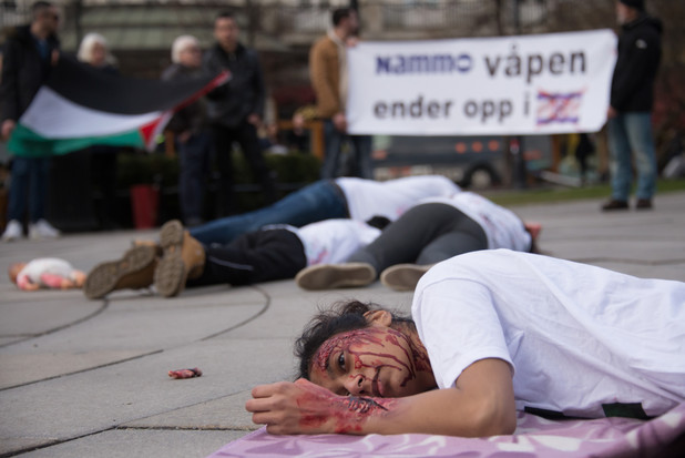 Palestine solidarity activists stage a die-in outside the Norwegian parliament in Oslo on 30 March.