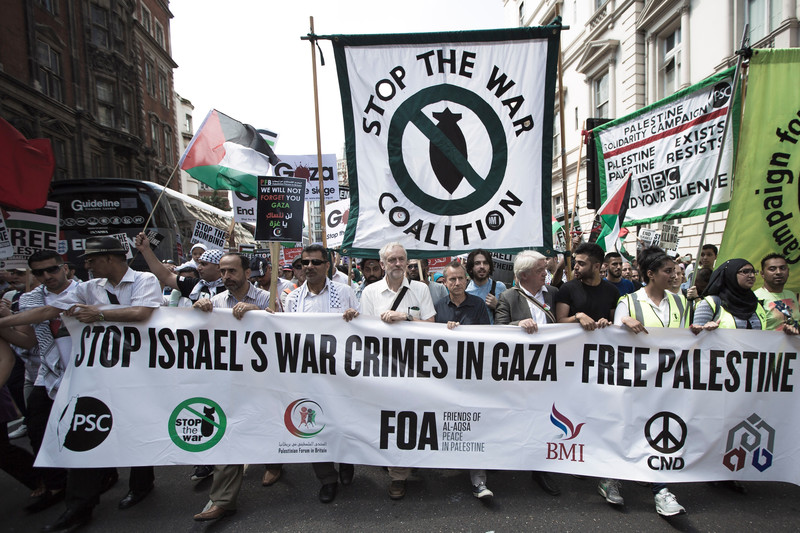 Jeremy Corbyn, center, attends a rally in London against Israel's bombing of Gaza, 26 July 2014. The left-wing lawmaker has been elected leader of the UK's main opposition Labour Party. Mark Esper Polaris
