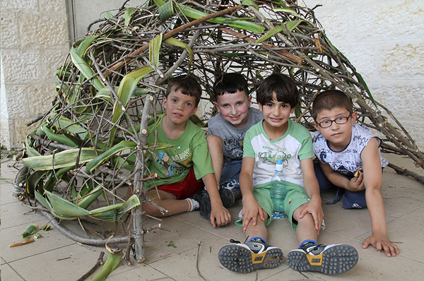 Four funhut builders, Jeruselem, Israel