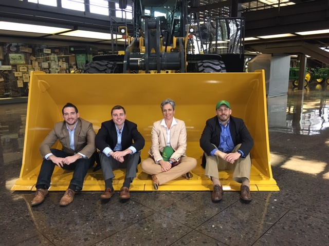 Brendan Carroll of Skycision, Austin Webb of Robotany, Alicia McGinnis of Fortyx80 and Jorgen Pederson of RESquared tour the floor at John Deere's international headquarters in Moline, IL.