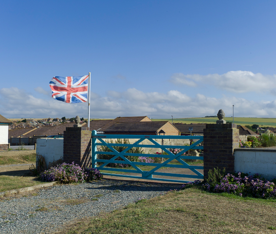 sub urbia flag and gate.jpg