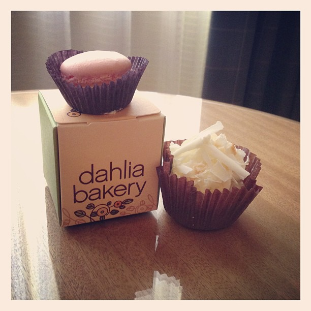Mini coconut creme pie and a French macaron (at Dahlia Bakery)