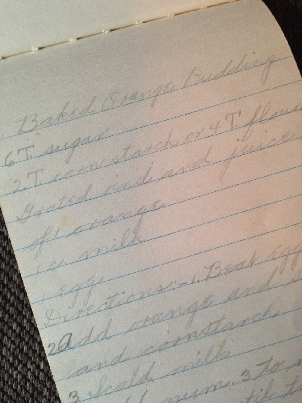 A recipe for baked orange pudding by my Grandma Marion in her old notebook.