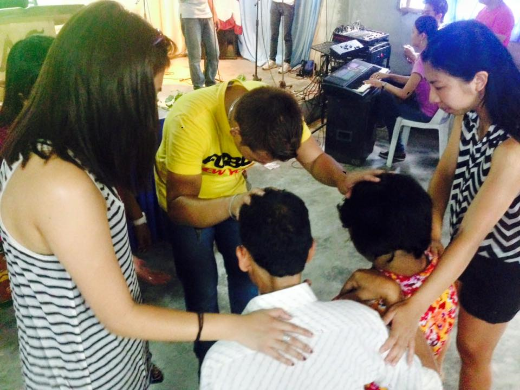 Praying for the pastor of the new River of Life daughter church in the Philippines.