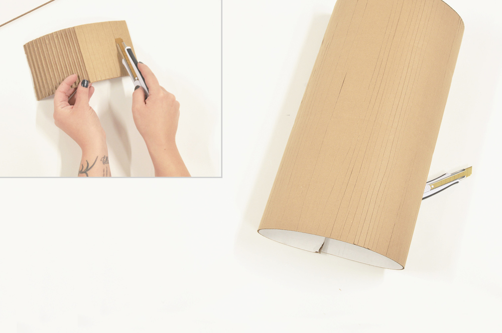 Cut vertically between the corrugate to allow the cardboard to bend easily.