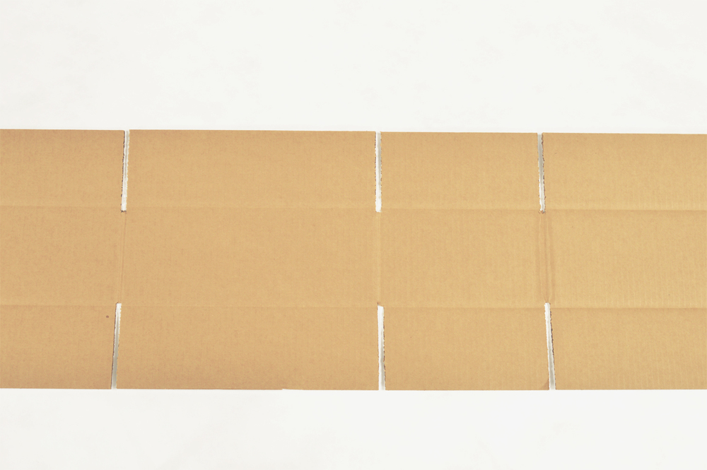 Break down the box so that it lays completely flat.  Then cut  at the folds to separate the box into 4 panels.