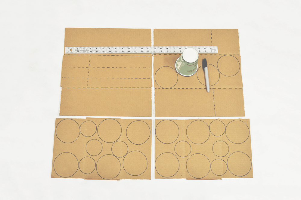 Using a cup and a ruler trace this template onto your cardboard pieces. You will need 16 Large circles  and 8 small circles in total.
