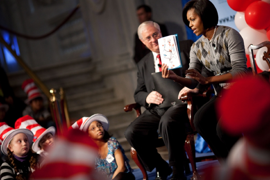 "First Lady Michelle Obama reads ""Cat in the Hat"" at the Library of Congress in Washington, D.C., March 2, 2010. (Credit: White House)"