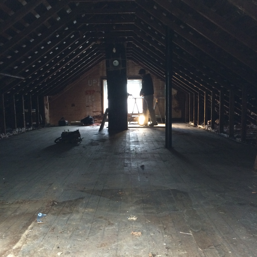 This homeowners attic was an empty space with no finishing touches. Watch the progression from this photo to a master suite + bonus nook!