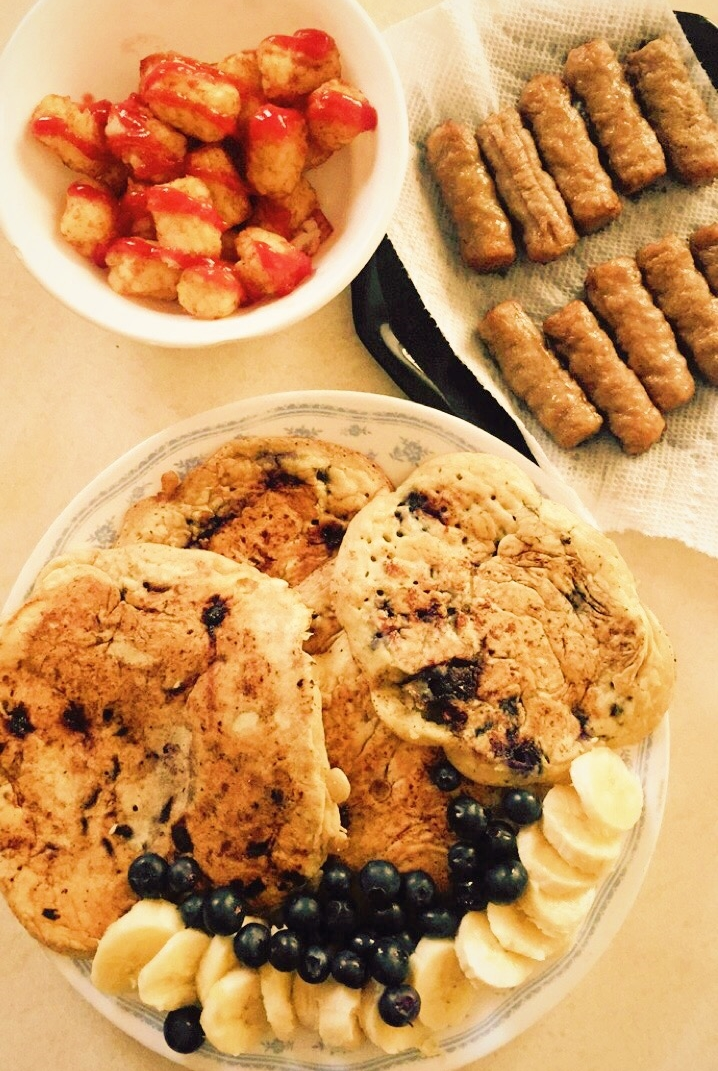 Chocolate chip blueberry pancakes, sausages, and tater tots