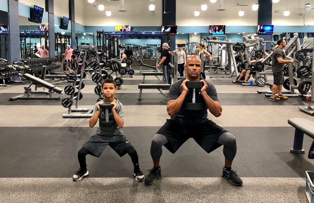 Dondré working out with his son, Dré.