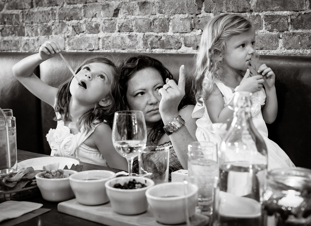 Mother_with_daughters_at_restaurant.jpg