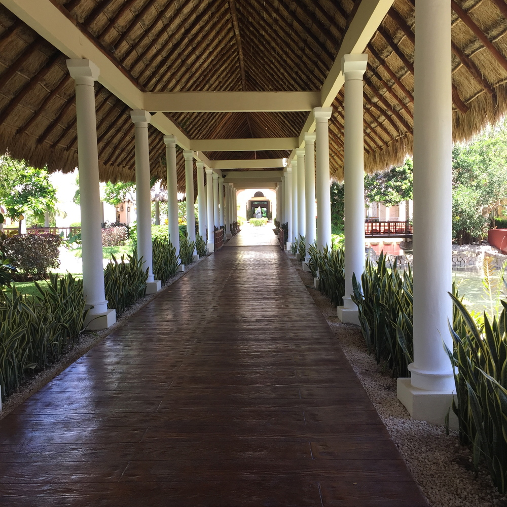 """The walkways and floors were beautiful. The papala-cover """"roofs"""" were everywhere and I loved that feel. Also, we love ourselves some pretty wood flooring so we loved this."""