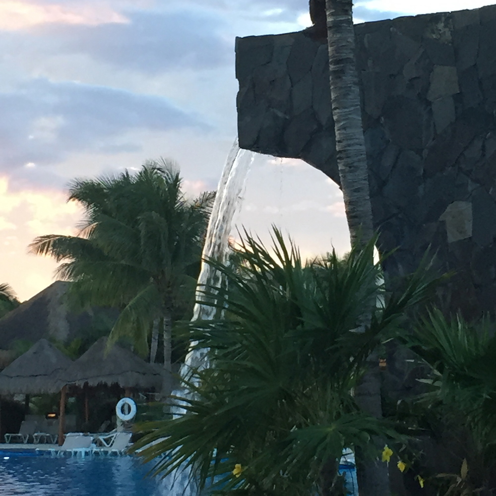 """The bigger pool (what we called the """"party pool"""" in comparison to the private one we liked), was really nice. Just a lot more crowded and loud. There were a few swim up bars, as well as a little food buffet to grab lunch at."""