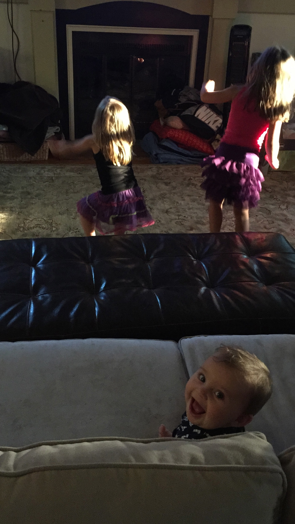 Isaac having a blast watching his sissies do the Whip and Nae Nae. SOOO funny these little people!