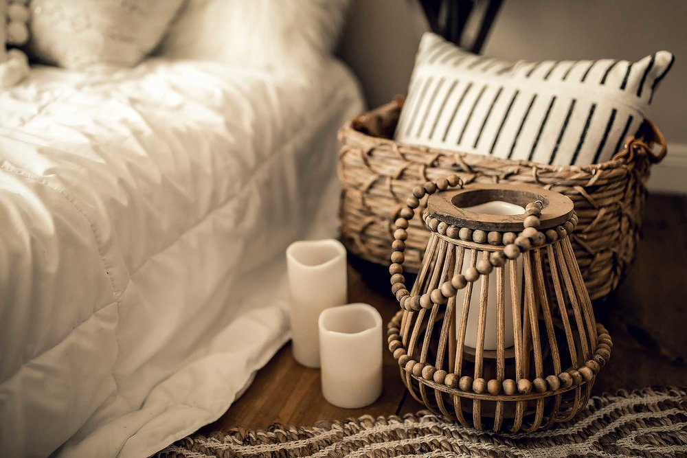 shelby-schiller-photography-lifestyle-studio-hand-lamp-with-white-candles-and-geometric-pillow-in-basket.jpg