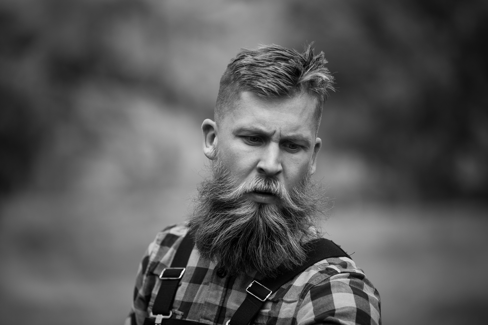 Unknown. But his beard is on point.
