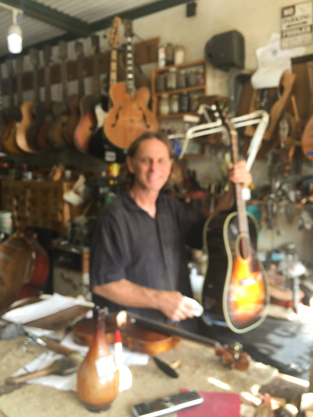 Salvador Giardina - Holding my repaired Gibson LG2 in his shop in Old Metairie. Sorry for the blurry picture.