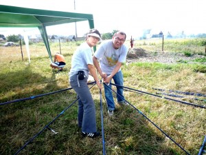 Calvin and Lisa are working hard to put up tents for Romani children