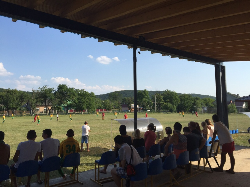 Watching local soccer teams play, and cheering for members from the House of Mercy