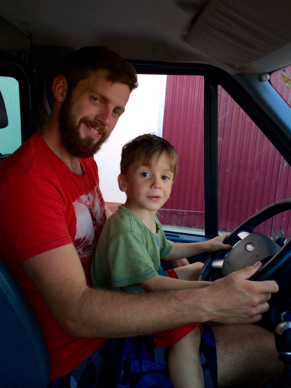 """Meet our new eager """"driver"""" little Andrew before our market visit."""