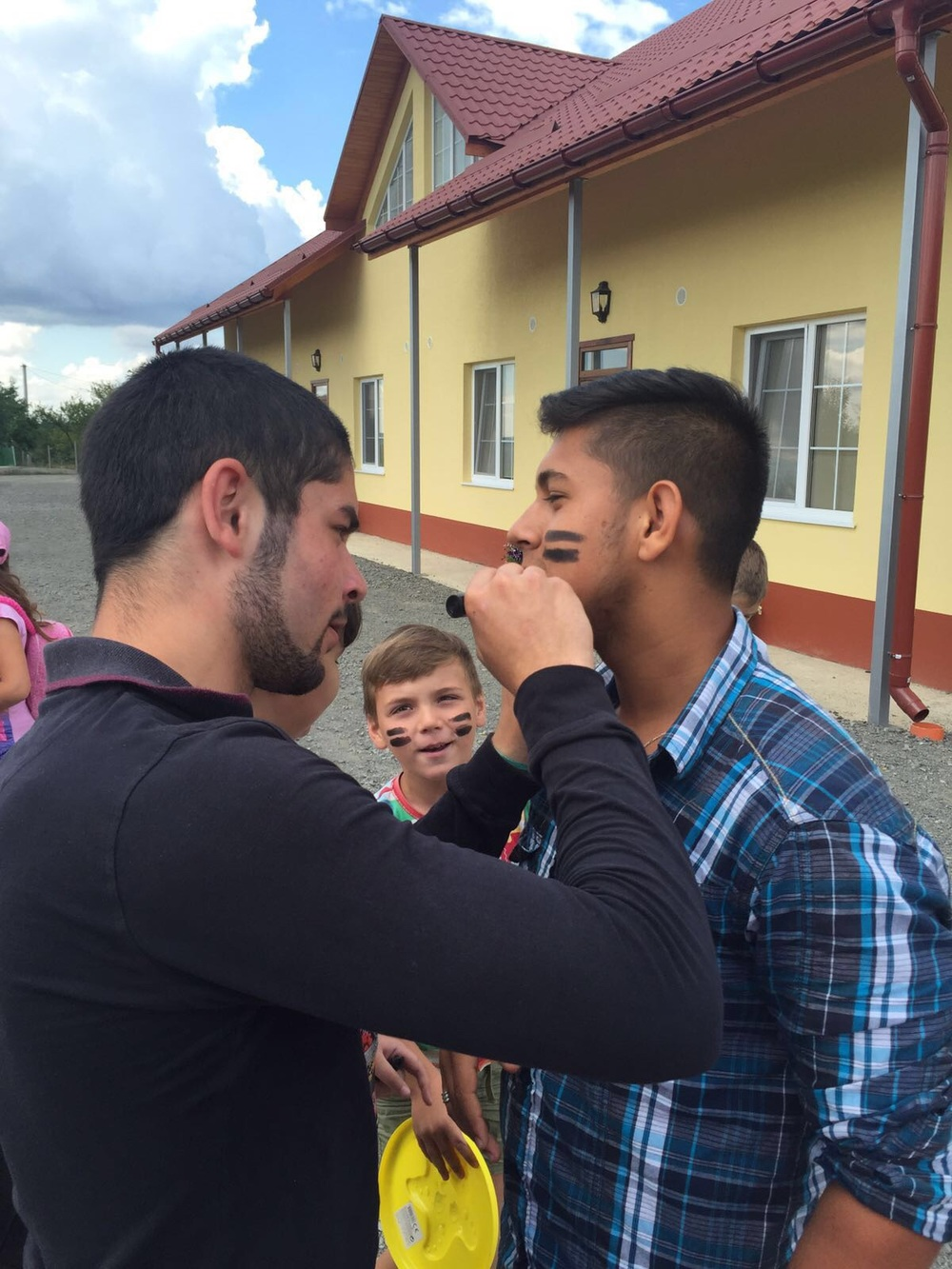 For the first time, we have Roma leaders leading in our Camp. Here are Victor and Victor trying out face painting.
