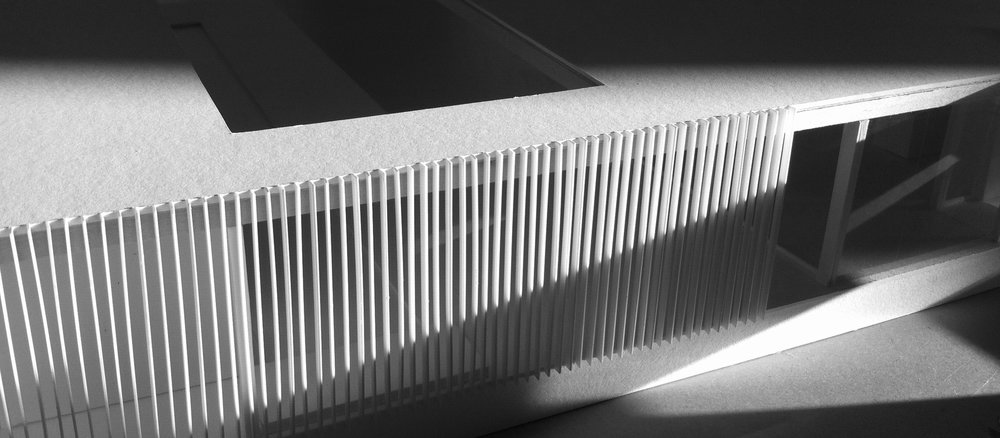 Sunlight hits the model facade