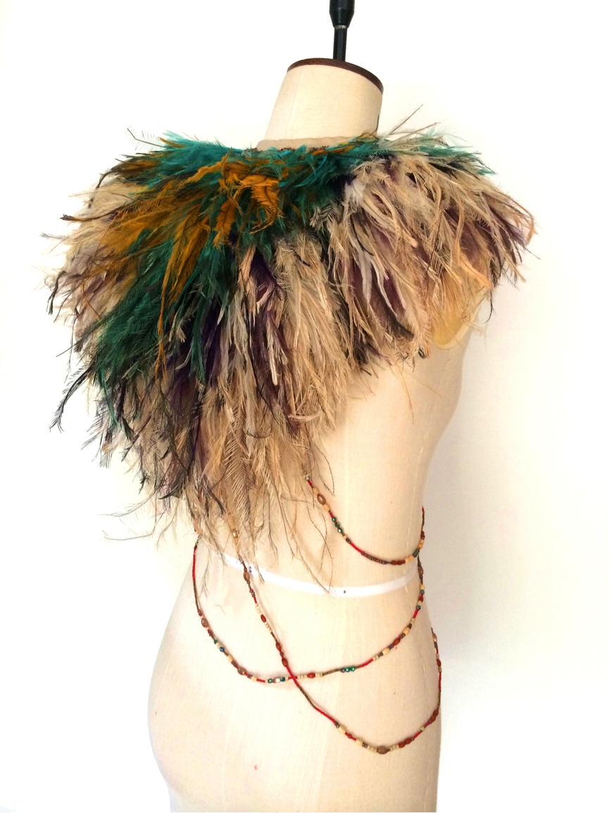 The emu ruff is inspired by the feathered headdresses (enkuraru) of the Massai warriors of Kenya. It is meant to play with themes of Colonialism and homogenisation and insensitive appropriation of cultural material.