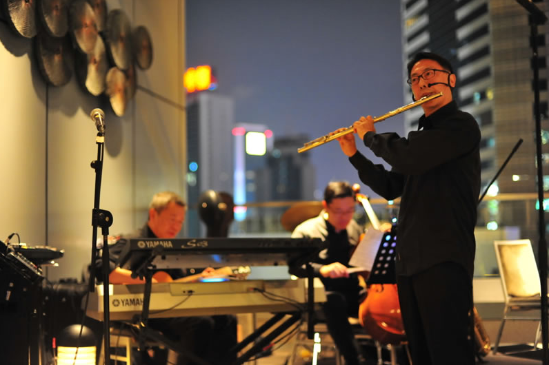 Music filled the air high up on the 27th floor of the Crowne Plaza Hotel