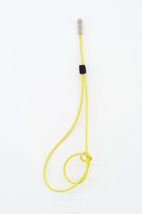 Feedback Loop - Neon fragment #2 , 2012 noise canceling instrument cable, brass wire and felt 48,7 x 15,2 x 5,1 cm