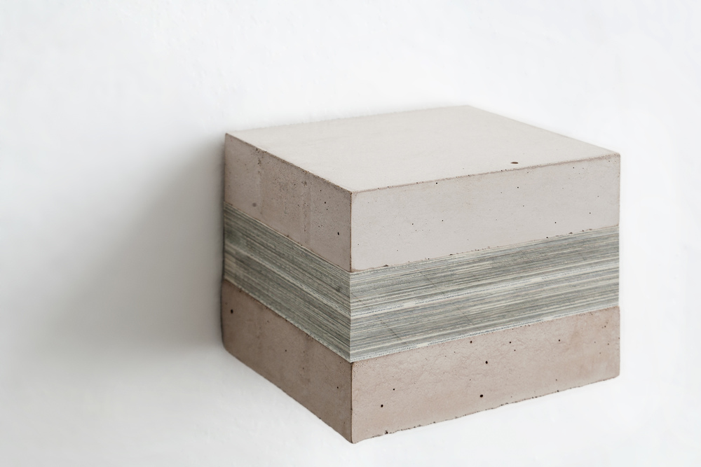 Fernanda Fragateiro,  Concrete Words #1,  2015  s tainless steel support, pigmented, concrete blocks, block of book sections 16 x 14,3 x 12,3 cm