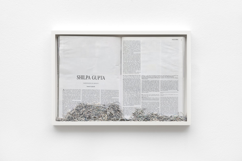 Maria Anwander,  Ereased Gupta , 2014, framed magazine and eraser abrasion, 31 x 45.5 cm