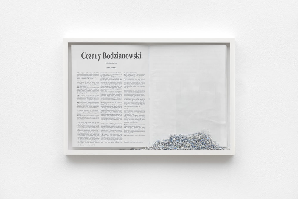 Ereased Bodzianowski , 2014 framed magazine and eraser abrasion, 31 x 45.5 cm