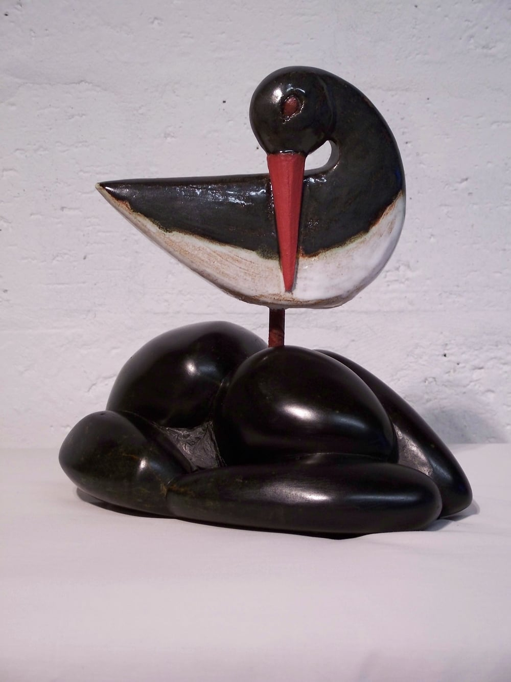 Oystercatcher on Black Beach glazed stoneware on serpentine stone 30 x 35cm £770