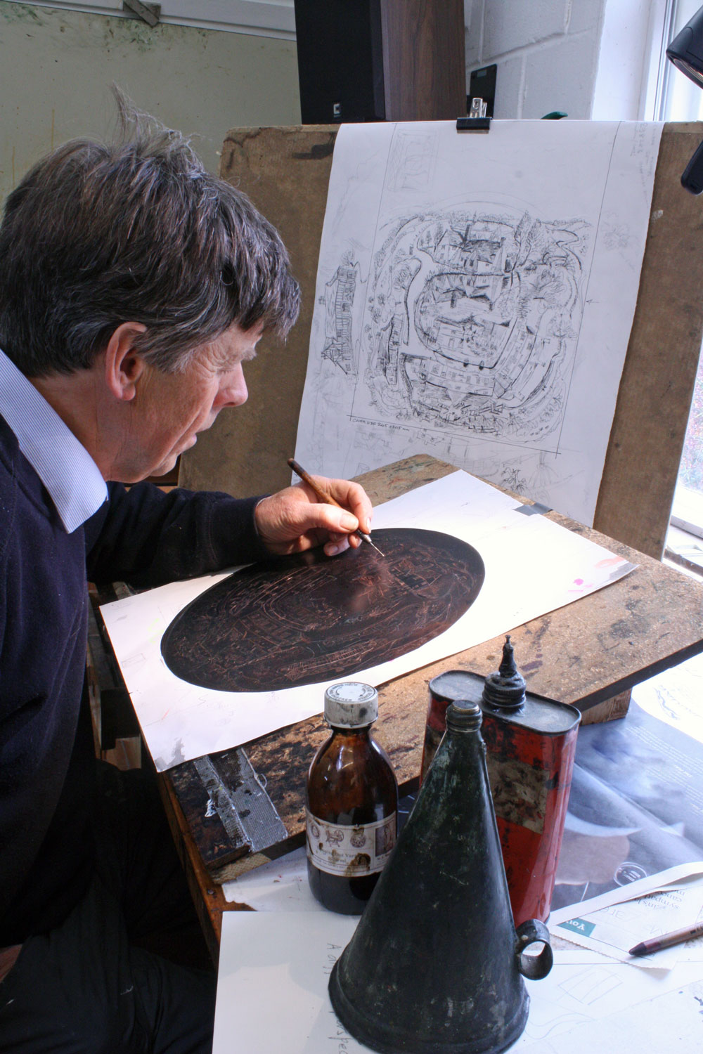 Glynn Thomas  drawing on a plate