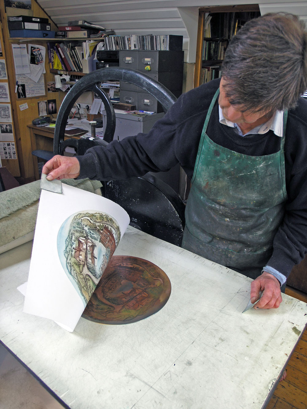 Glynn Thomas  lifting a print from the press
