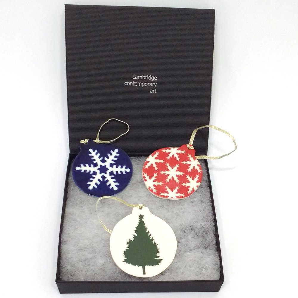 Saya McNairn-Yanagi Small Red Snowlfake Decoration £10 Big Dark Blue Snowflake Decoration £10 Green Tree Decoration £10