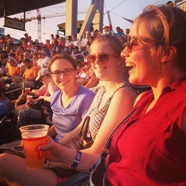 """Left to right: Jenny; Jenny's wife, Kate; and Christa (previously featured in our """"Where Are They Now?"""" series) at a Nationals baseball game with the NVRDC case management team in July 2014."""