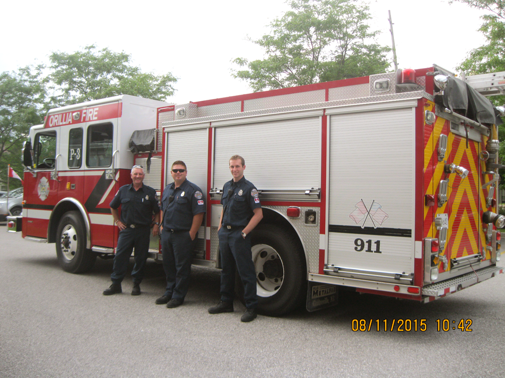 Firefighters and fire truck visiting